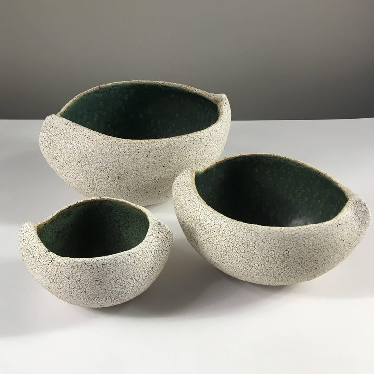 Contemporary ceramic artist Yumiko Kuga's glazed stoneware set of three boat shaped bowls no. 174 are part of her Crackle series. All of the pieces in this series are hand-built and 100% handmade so they are one-of-a-kind and thus vary slightly from