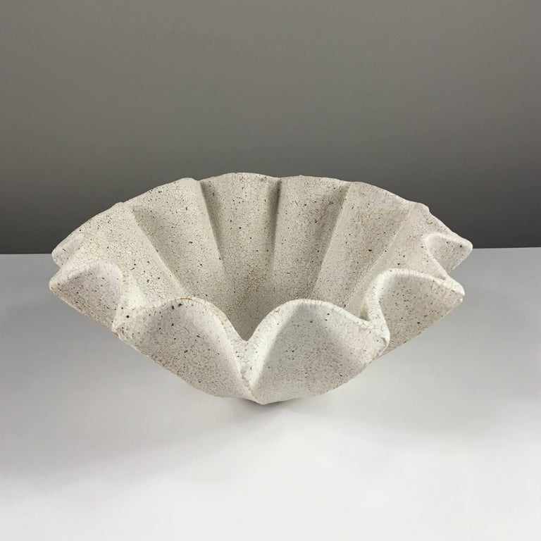 Contemporary ceramic artist Yumiko Kuga's glazed stoneware star bowl no. 211 is part of her Crackle Series. All of the pieces in this series are hand-built and 100% handmade so they are one-of-a-kind and thus vary slightly from one another. All