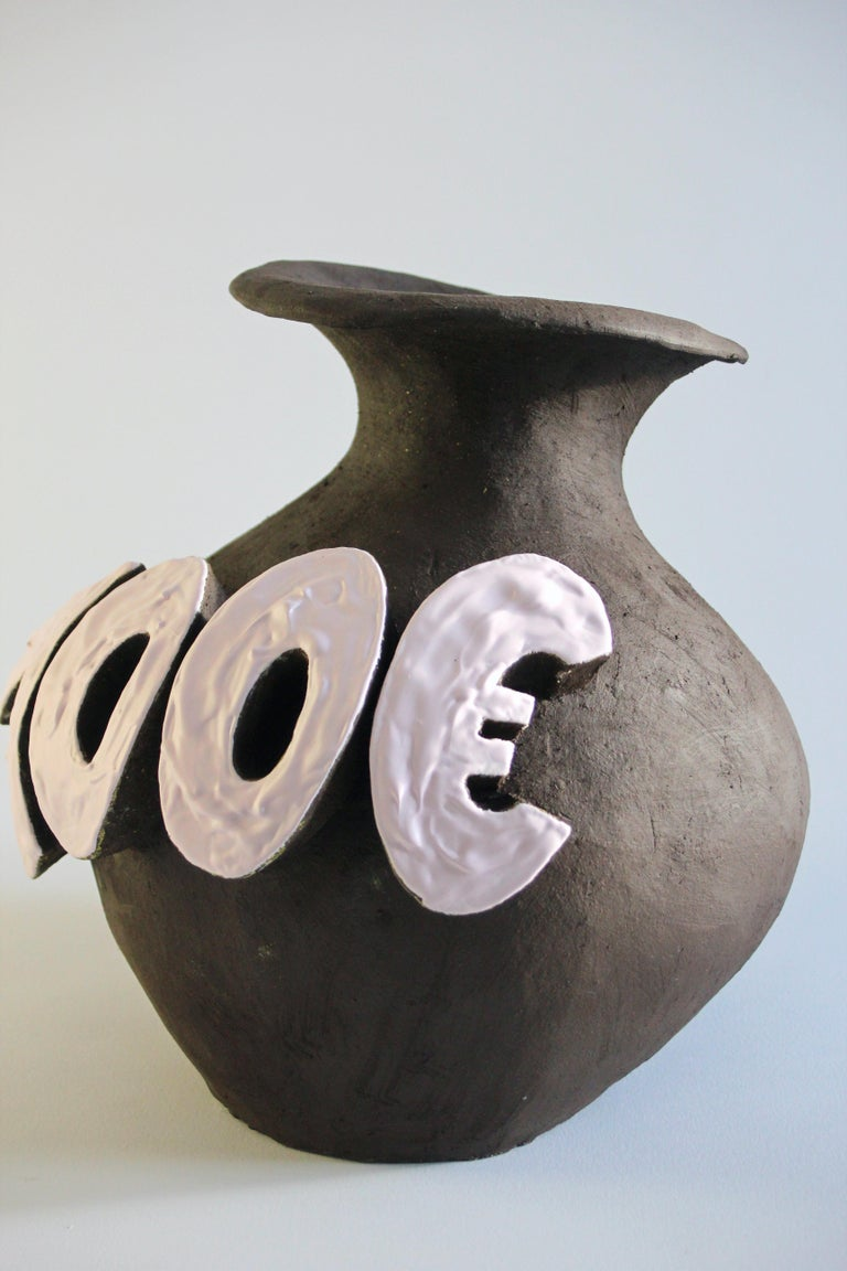 Contemporary ceramic vase with cartoon font, designer Teemu Salonen, Finland.  700€ Ceramic vase design object. This is one-of-a-kind product and hand built ceramic. On the side of this vessel is cartoon styled fonts with word 700€ Letters are