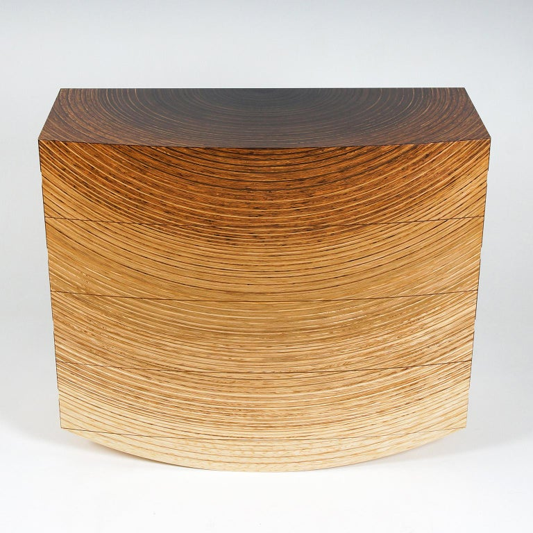 The contemporary 'Radiant' chest of drawers by Edward Johnson forms part of his Murano Collection. The pieces in this collection all utilise Edward Johnson's unique 'Murano' veneers that have been developed and produced in his workshop.  The chest