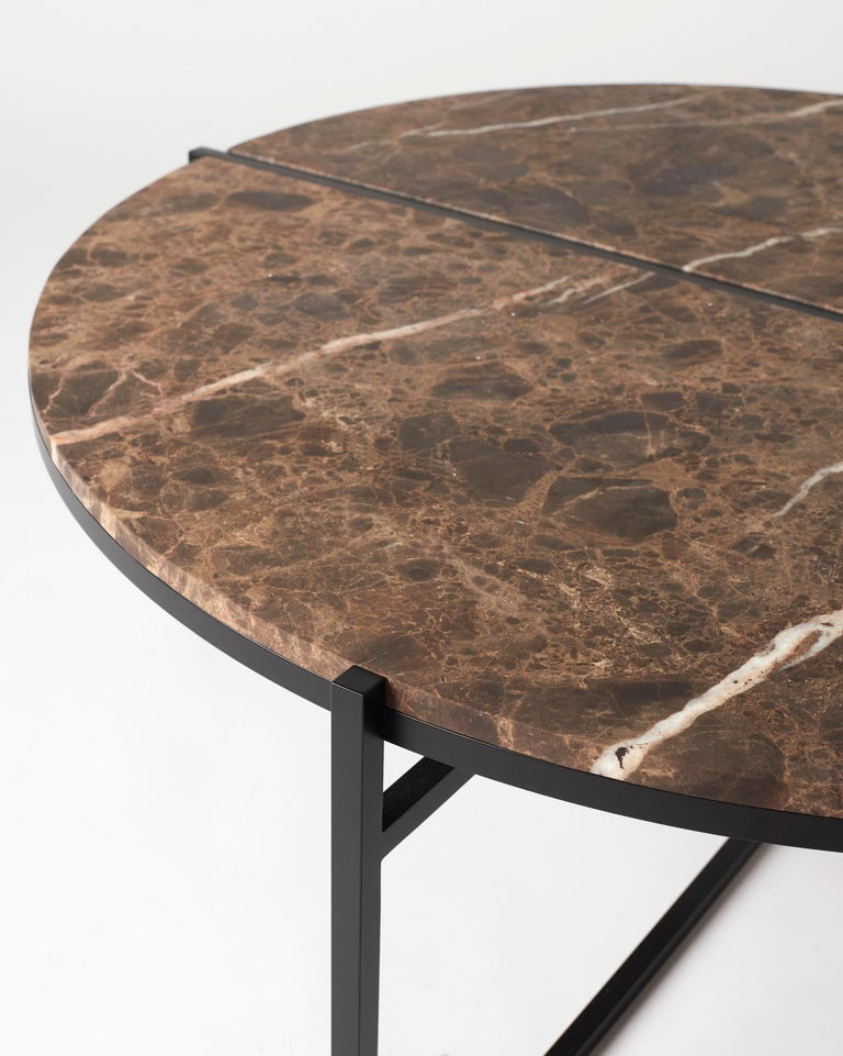 The other way round coffee table creates sophisticated and sculptural aesthetics for any room with its characteristic cut of the top plate, beautiful mirrored frame and clean visual lines.  The mirrored frame creates a shifting effect and separate