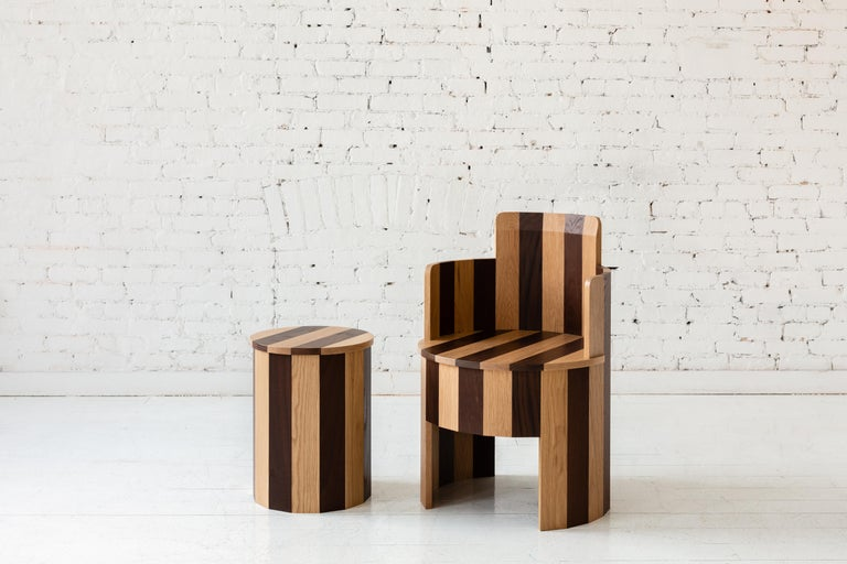 This side chair is a part of the new Cooperage Dining collection. Each piece features large faceted round elements that with its namesake reference the traditional cooper's trade of making barrels.  The occasional chair table is shown in a bold