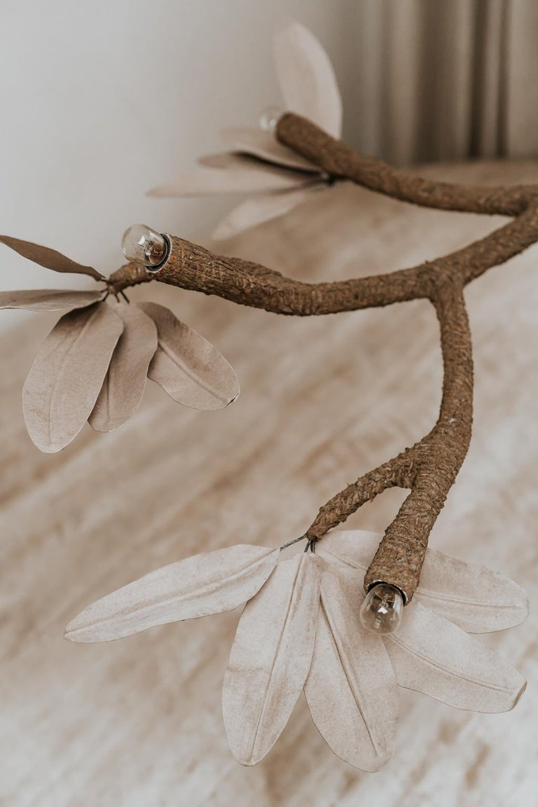 Poetic lamp made by J. Esteves, who is inspired by nature and created this chandelier.