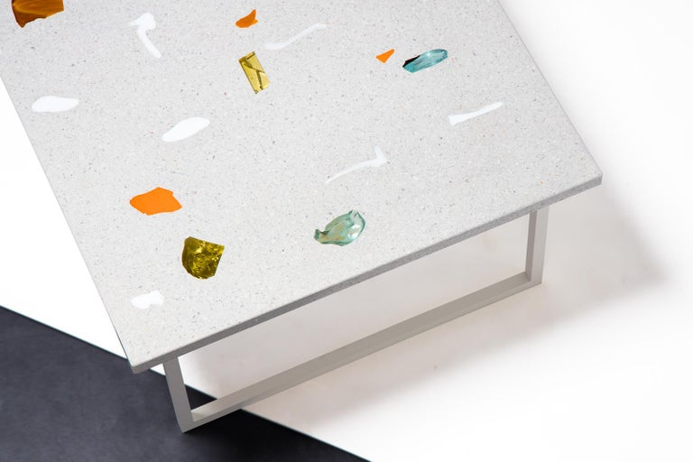 This coffee table is a key object for any curated living room. The multicolored glass chunks — called neoterrazzo by Basis Rho — decorate an otherwise monolithic tabletop like large colored brushstrokes. The CFE TBL is part of 'The Painting in Stone