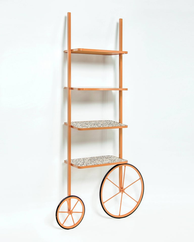 The design for Cyclopedia stems from the high wheel bicycles of the 1870s. Unlike most bookshelves, Cyclopedia differentiates itself through its portable structure. This unique piece is a library and a display shelf that can be wheeled and