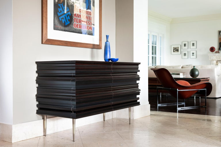 Finest crafted darkened wood moldings and lacquer credenza. Moldings are applied to conceal drawers and acting as handles for the piece. The process to achieve the credenza 's surface is the result of the combination of multiple moldings with