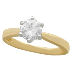 Contemporary Diamond and Gold Solitaire Engagement Ring