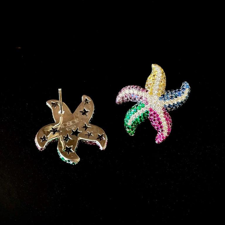 Contemporary Diamond, Sapphire and Emerald White Gold