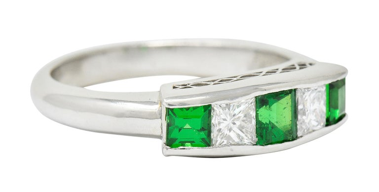 Band style ring channel set to front with tsavorite garnet and diamonds, alternating  Total diamond weight is 0.40 carat with F/G color and VS clarity  Bright green tsavorite garnet weigh in total 0.67 carat  Completed by a pierced lattice