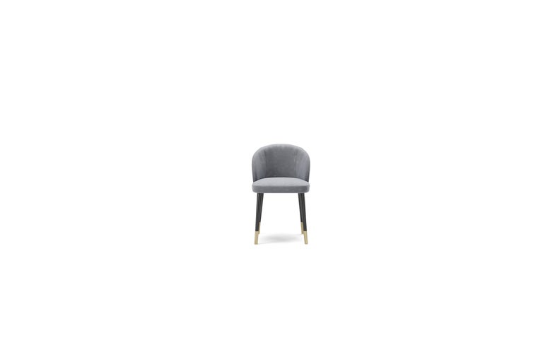 Dalia dining chair, a wood padded structure with multi density foams. The seat has swooden frame with interwooden belts and comes in a velvet, leather or nabuk.