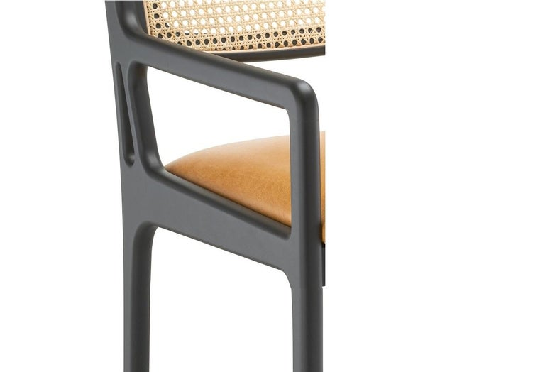 European Contemporary Dining Chair Featuring Natural Rattan Backrest For Sale