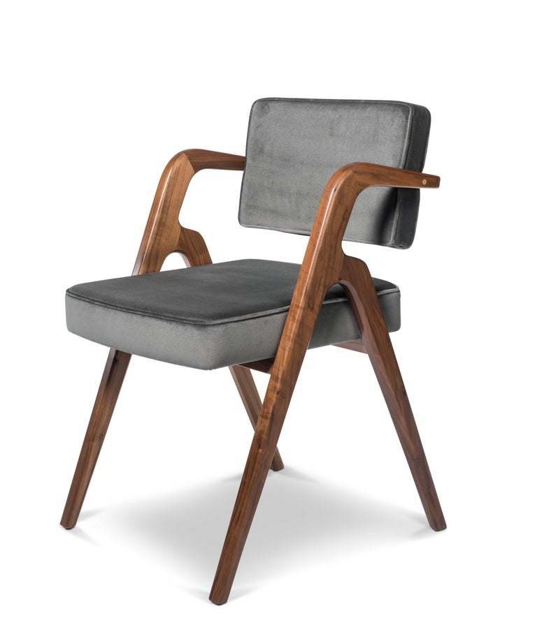 This contemporary dining chair with elegant scissor legs and floating back is inspired by the Mexican midcentury chairs of Eugenio Escudero that once overlooked the Bocochibampo Bay of Sonora in the 1950s. The tapered legs with chamfer details and