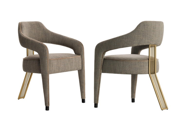 The beauty and strength of this design come from the simple construction between the leg and backrest spindles. The handcrafted chair features a textured weave fabric with neutral shades and a piping in velvet.  Dimensions: 58 cm x 58 cm x 81