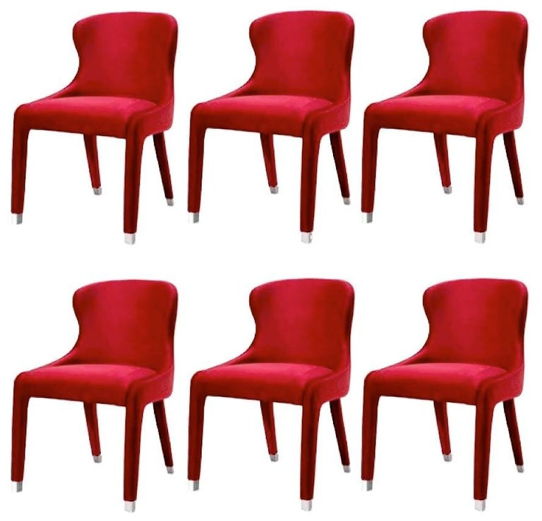 Fully upholstered dining chairs in deep red velvet. Stainless steel caps in polished chrome. 100% European handmade product. Available in COM and other velvet and metal finishes.