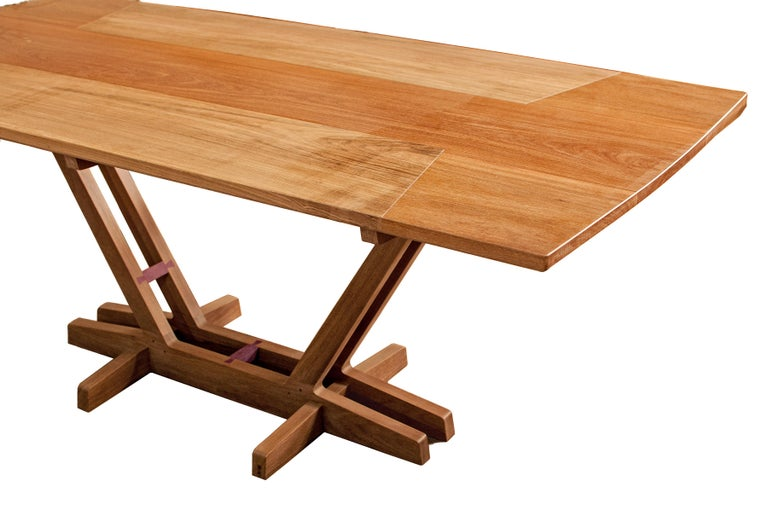 Dining table made with select tropical Brazilian hardwood by Ricardo Graham Ferreira.  Solid table top and base composed by two wood species assembled with traditional wood joints.  This dining table can be custom-made to fit specific dimensions.