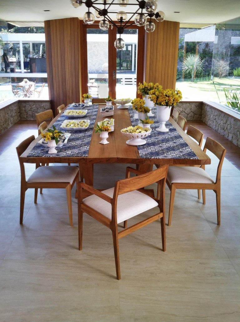 Contemporary Dining table made with selected tropical Brazilian hardwood. Contemporary Brazilian Design.   The dining table has a solid knock down tabletop and strong base assembled with traditional wood joints.  This table can be