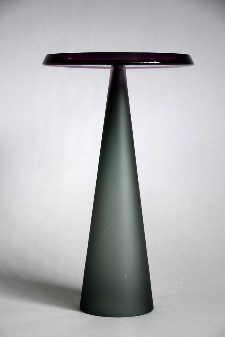 Stylish and elegant Dominio hand blown side tables. These beauties can be made in any color upon request but please note that because of the hand blown procedure the color will vary. Also due to the hand blowing, hand cutting and hand polishing