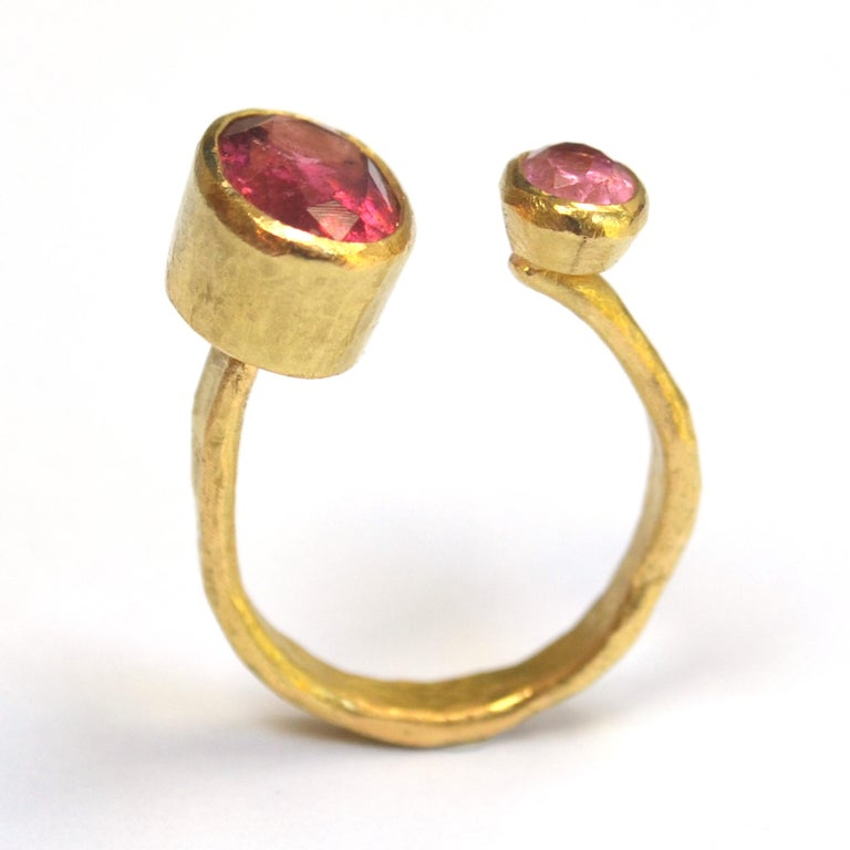 18k Gold textured open ring with two oval Pink Tourmalines, approximately 3 carats and 0.75 carats each.  This ring has been handmade by Disa Allsopp in her London Studio. Disa is inspired by ancient jewellery and uses traditional Goldsmithing