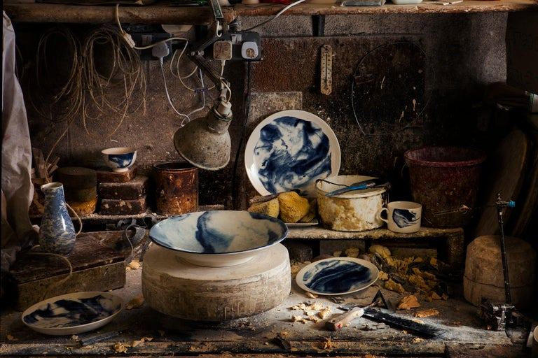 Indigo Storm, 1882 Ltd. with Faye Toogood. Faye Toogood's range of ceramic designs for 1882 Ltd. celebrates the accidental beauty of natural imperfections. Indigo Storm is a bold interpretation of traditional creamware forms; drawing upon the chance