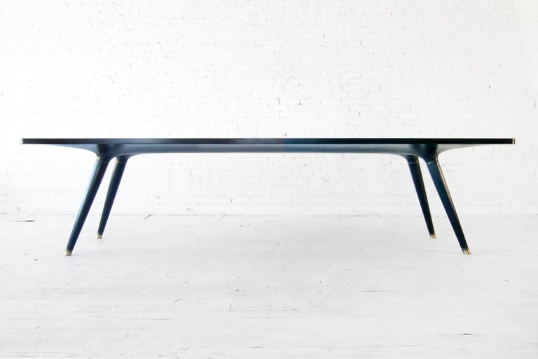 Ebonized dining table 001 from Series001 by Vincent Pocsik.  Vincent Pocsik finds the balance between old and new fabrication techniques working in conjunction to find an anatomical form that creates its own presence. Series 001 is about finding