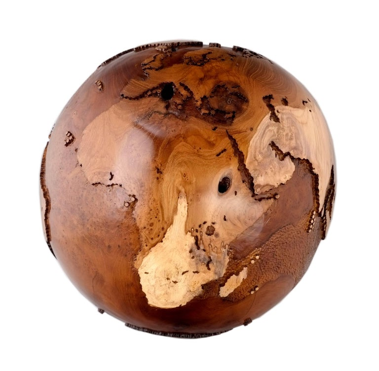 Your vibe speaks volume louder than any words could ever speak.  Eclat Vibe, hand-carved wooden globe with a burst of interesting patterns throughout the piece; It has natural burl with swirls, eyes, and twirls that create a unique, highly