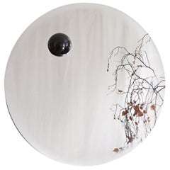 Contemporary Eclipse, Steel Mirror with a Diabase Stone