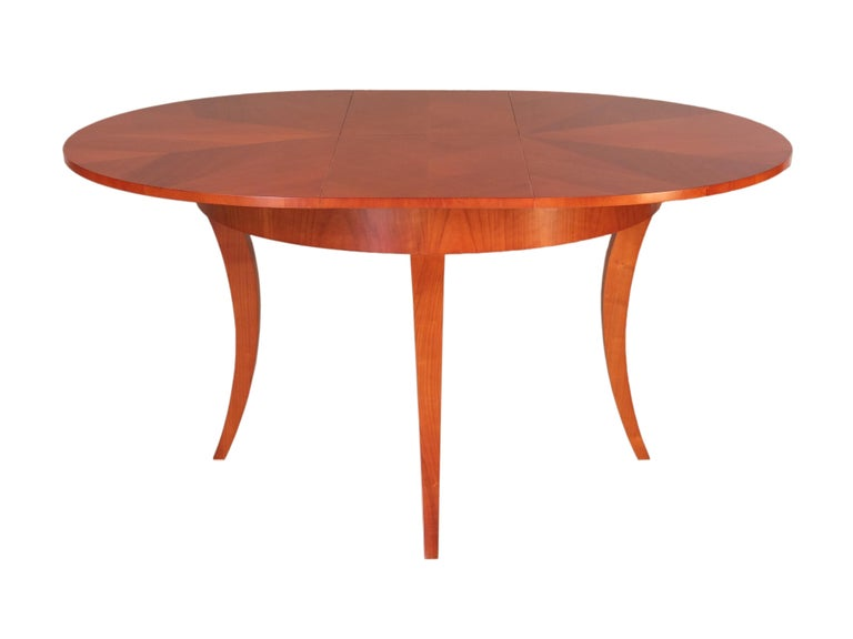 Contemporary round extendable table in Biedermeier style made of cherrywood. Precious inlay on the top. The extension is stored inside.  Measures when open: 160 x 120 x 78.