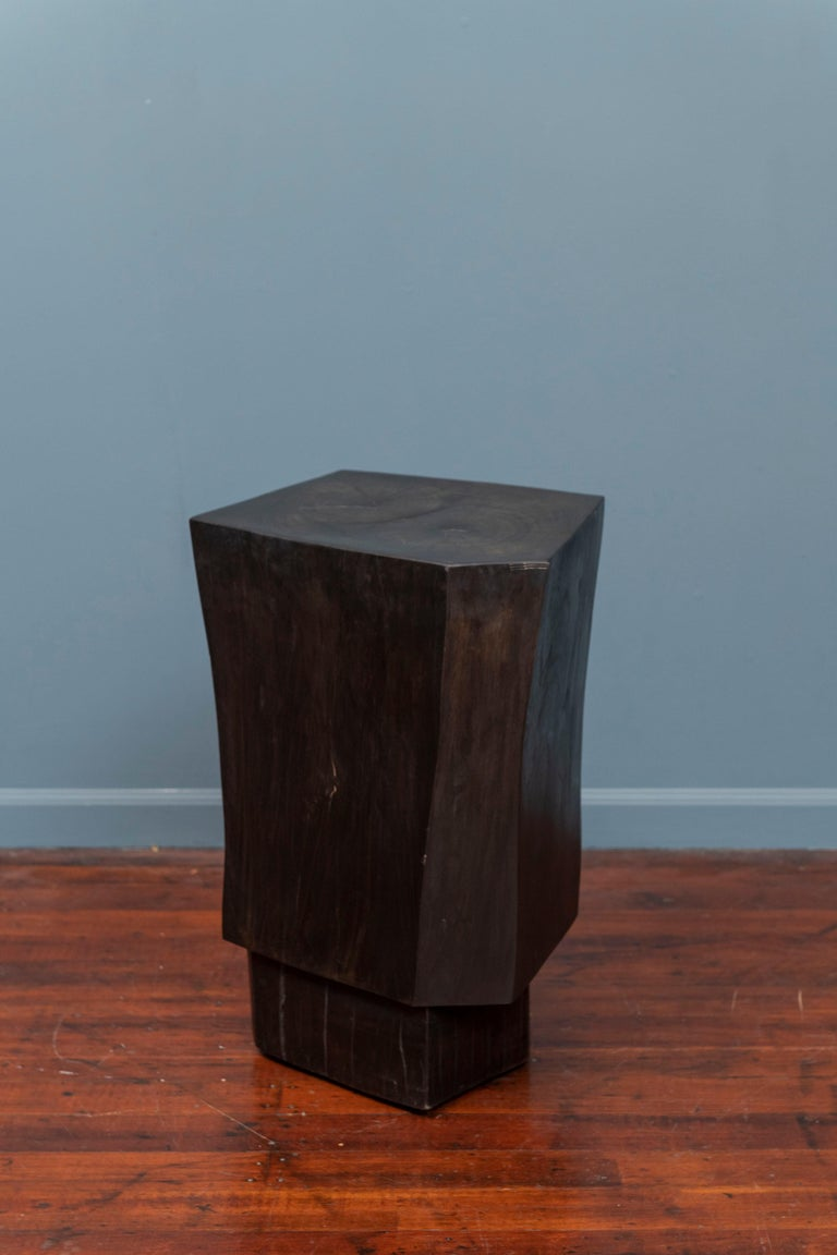 Contemporary faceted and ebonized side or pedestal table.