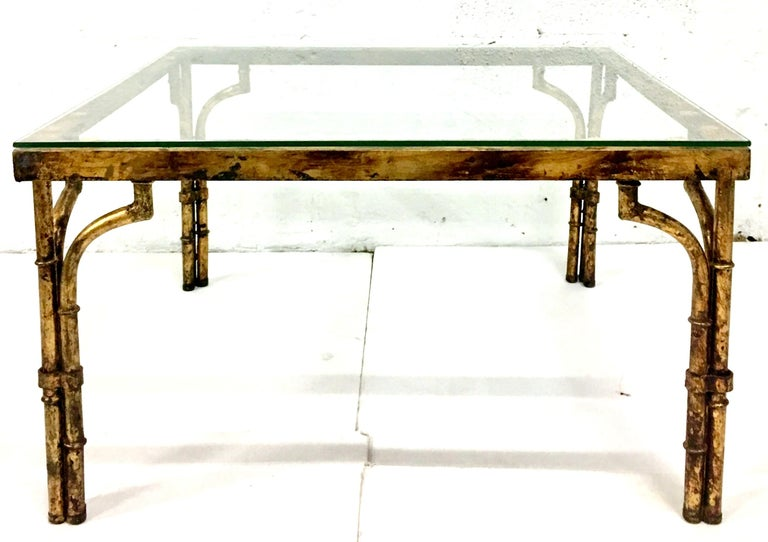21st Century Contemporary & New faux bamboo aged gilt gold iron glass top coffee table. Glass top is .25