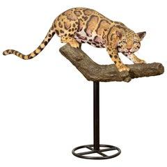 Contemporary Fiberglass Leopard Sculpture Mounted on a Tree Base