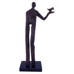 Contemporary Figurative Sculpture Holding Bird