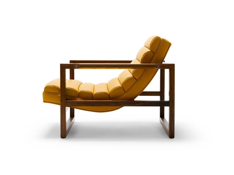 Created with the ultimate lounging comfort in mind and featuring a subtly detailed oiled walnut frame, the Florence is pure statement. It works well upholstered in fabric but our recommendation is lustrous leather in a bold color. Shown here in