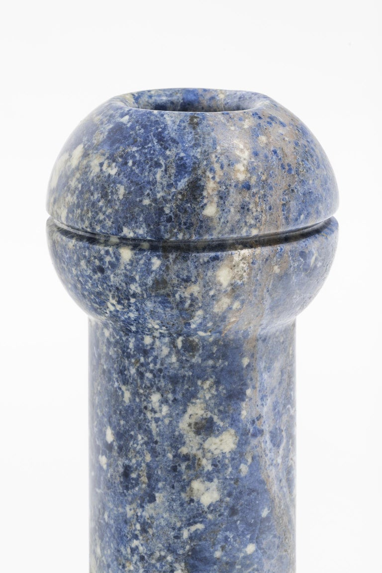 Geometric sculptural vase in Sodalite marble, Simultanea collection. Centripetal, centrifugal and movement forces are channeled into stone forms and a rotation on the axis become a vase, while an inclined cut suggests a container. Like a mechanical
