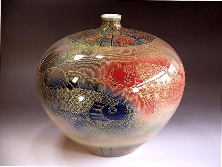 Exceptional intricately hand-painted large contemporary Japanese decorative Imari porcelain vase. The palette of colors showcases hues of brilliant red, cobalt blue and gold on a striking ovoid body. In 2016, the British Museum added a work by this