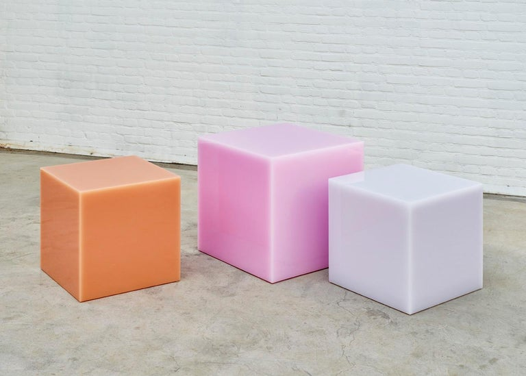 Seemingly solid objects with a magical glowing edge. The unique translucent and highly polished properties of the material give a magical effect to these multifunctional pieces.  Color: Peach (pictured) Measures: 60 x 60 x 60 cm  Colours: Raspberry,