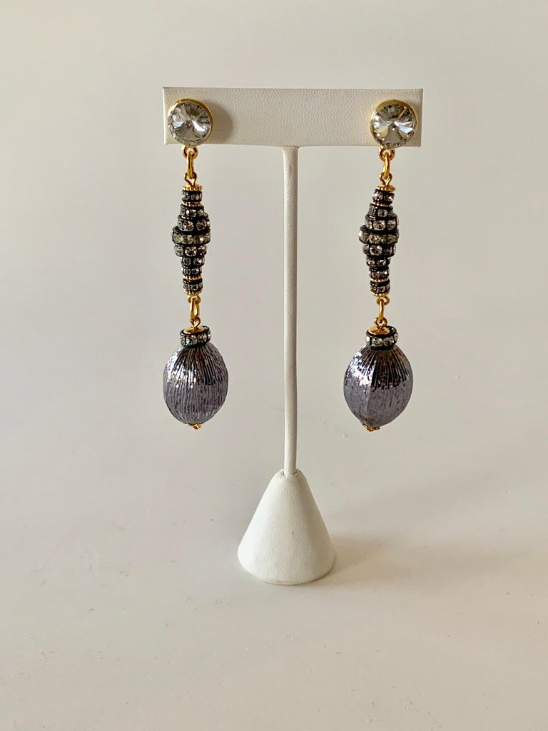 Contemporary gunmetal diamante drop statement pierced earrings made in Paris France - the drop earrings of japanned metal, diamante stones and are accented by large grey ribbed beads at the bottom.