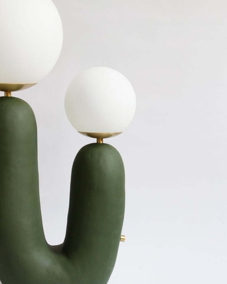 As part of the First Hand collection, the Oo lamps debuted at the International Contemporary Furniture Fair in 2018, where Best New Emerging Designer was awarded to Eny Lee Parker. This ceramic base is hand-built, with brass detailing including a