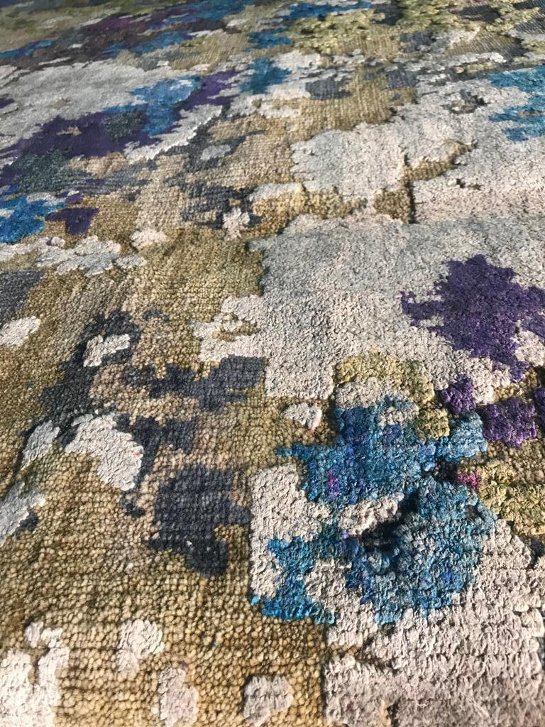 The Odyssey Collection a breakthrough, three dimensional and multi textural rug collection, inspired by NASA imagery. Distressed wool and natural silk are hand knotted to create three levels of visual and tactile finery. The collection pairs vintage