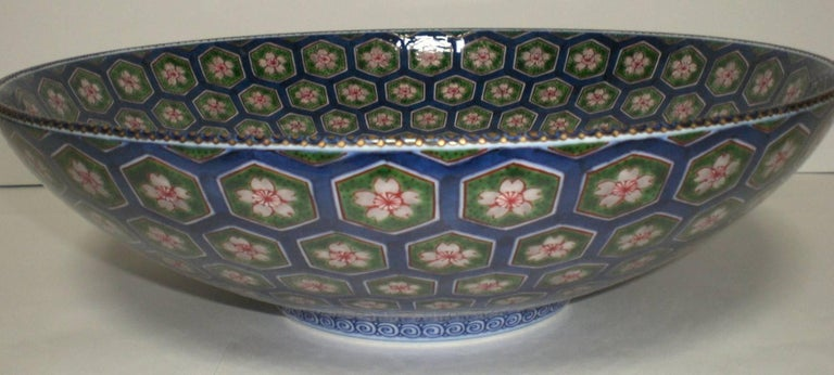 This exquisite large Japanese contemporary hand-painted porcelain charger-centerpiece is a masterpiece by master porcelain artist of the Imari-Arita region of Japan's southern island of Kyushu (1931-2009). The artist was admired for his detailed