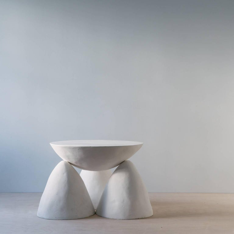 The Twyla-03 is sculpted from plaster and sealed with lime. It has three legs instead of the four legs in the Twyla-04. Sealed with lime, the finish is satin and resists spills and stains. To clean scuffs or spills, wipe with a damp, clean