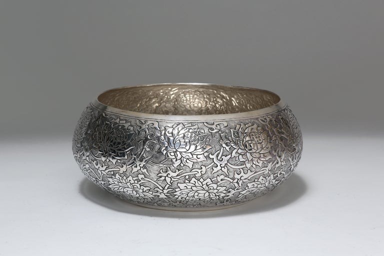The fine hand-worked solid silver bowl is meticulously chased with classic scrolling lotus motif. It is available in other sizes. Lotus is a symbol of purity, grace, elangcy and perseverance. The silver is 90% pure.