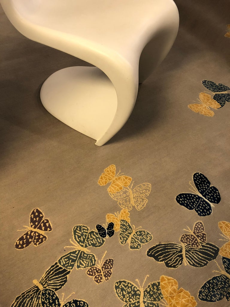 It's IN STOCK! Sergio Mannino Studio's collection of rugs is expanded with two new designs. Measures: 6' x 8'.  Hand drawn butterflies seem to come out of the floor. The background is wool, while the butterflies are made with silk. 150 knots.  The