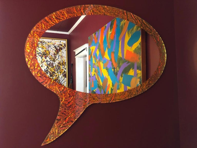 Crazy mirror is cut in the shape of a speech bubble which is familiar to anyone who has ever read comic books or animated novels.