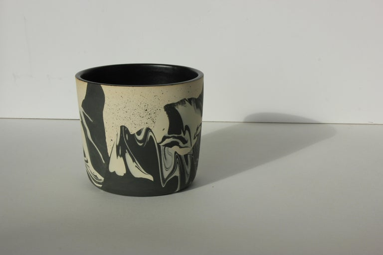 Handmade ceramic stoneware cup. Marbled raw colored clay exterior with satin black glaze interior. Available in other options. Handmade by Malka Dina in Brooklyn, NY. Due to the handmade nature of this item, each piece will be slightly unique and