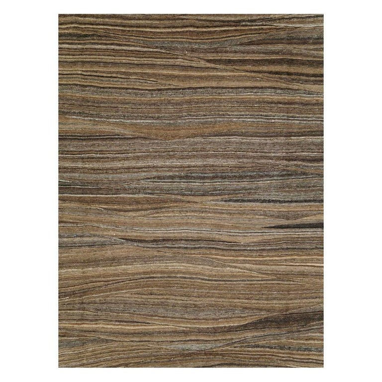 A modern Turkish flat-weave Kilim room size rug handmade during the 21st century. Various shades of brown striate across the ground of the Swedish inspired curvilinear tapestry weaving technique.  Measures: 9' 11