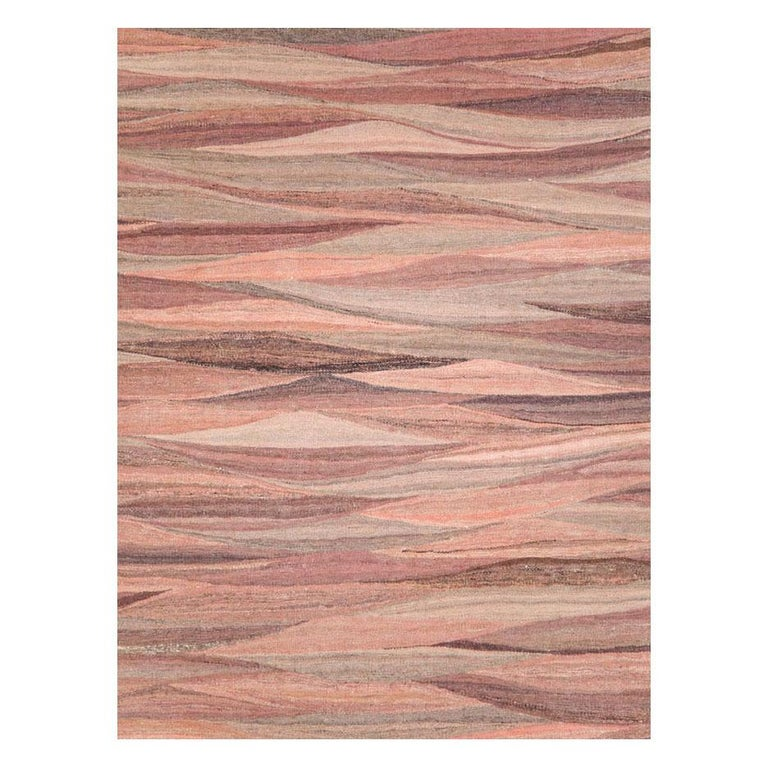A modern Turkish flat-weave Kilim room size rug handmade during the 21st century. Various shades of pink ranging from 'New York Pink' to 'Pastel Pink' striate across the ground of the Swedish inspired curvilinear tapestry weaving