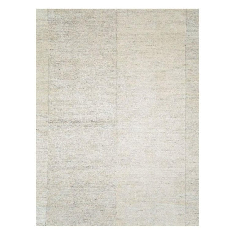 A modern Turkish flat-weave Kilim room size rug handmade during the 21st century with 6 subtly striated light beige and linen columns.