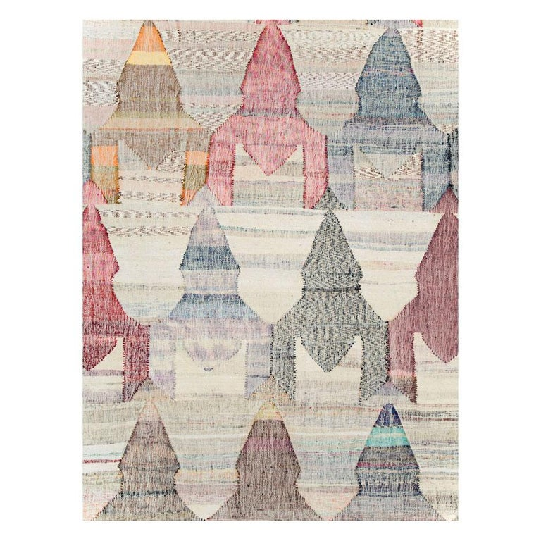 A modern Turkish flat-weave Kilim large room size carpet handmade during the 21st century with a colorful pastel geometric large scale pattern resembling circus tents over a white-beige background.  Measures: 13' 4