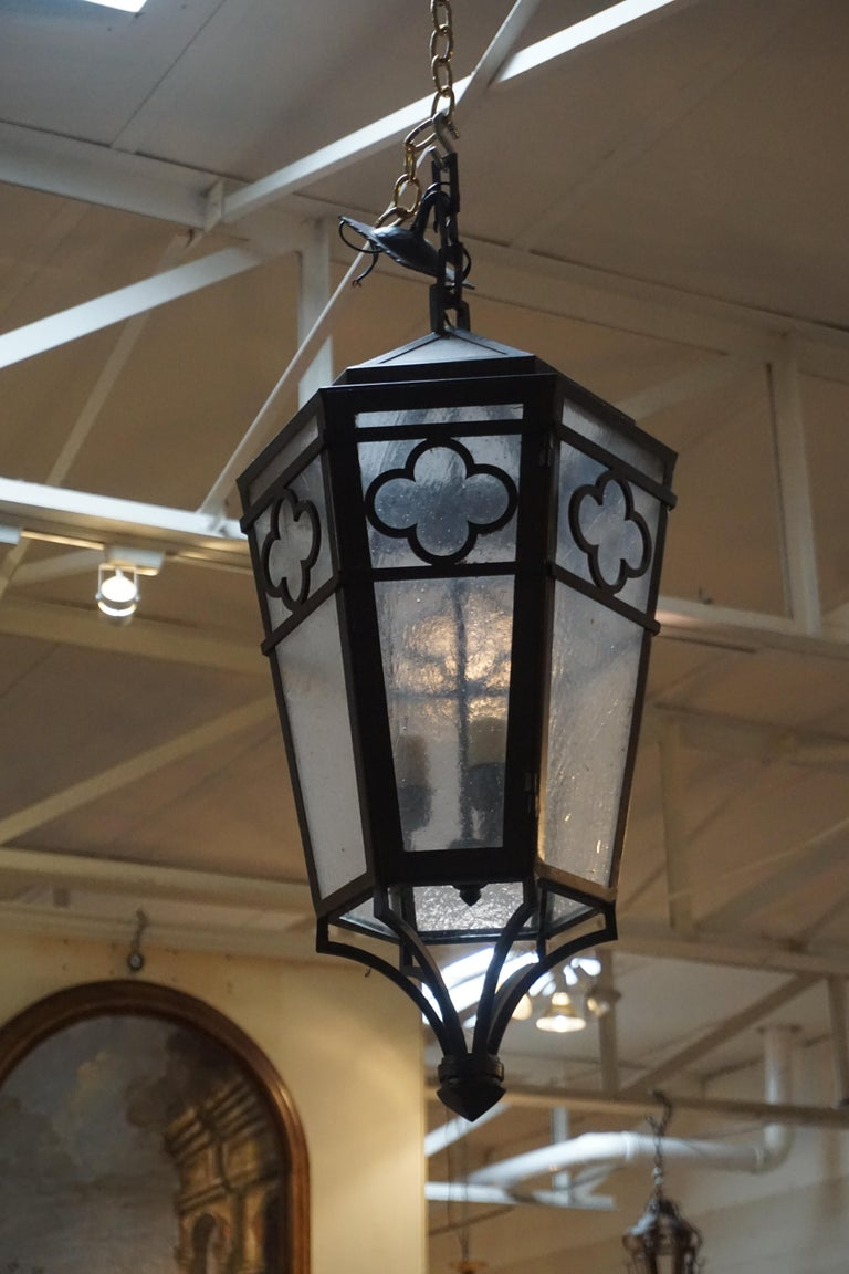 This hanging lantern features frosted glass for a soft glow and is wired, ready for install.  Measurements: 12'' D x 31'' H
