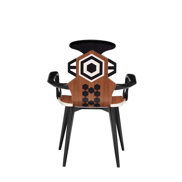 The hexagonal geometries and curved wood represent the inspiration for this chair. The back features a small area of padding with butterfly embroidery. Available in two versions that can be coordinated, High and Low chairs, here the Low